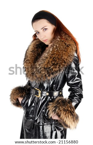 woman in leather overcoat with fur