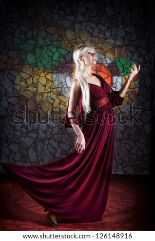 Woman in medieval fantasy dress, moving forward - stock photo