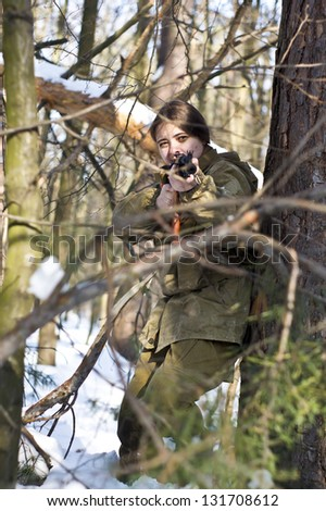 Woman in military uniform in the woods