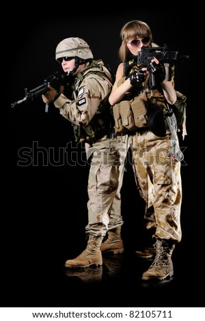 woman in military uniform with weapon - stock photo