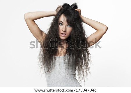 Woman in morning panic with unruly hair isolated on white background. - stock photo