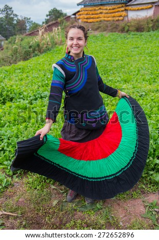 Woman in national costume with family - stock photo