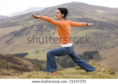 Woman in orange doing yoga