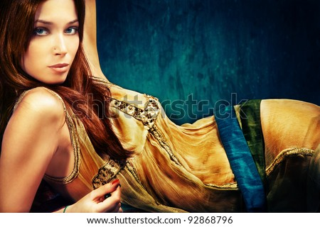 woman in oriental style clothes, studio shot - stock photo