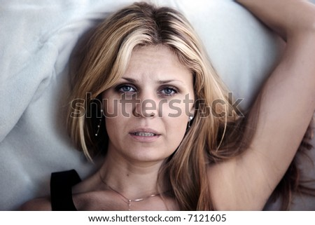 Woman in pain having problems sleeping - stock photo