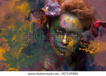 Woman in paint. Attractive and sexy girl. Face art. Bright make up and body art. Flowers in hair. Over creative background.