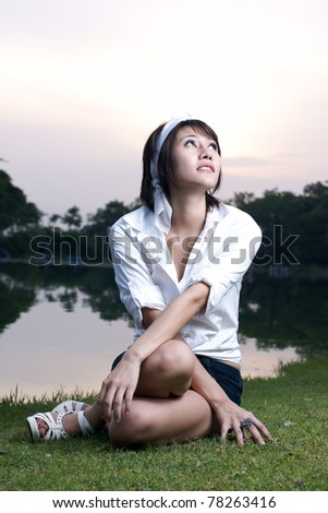 Woman in park - stock photo