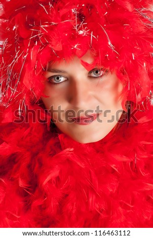 Woman in party gear with feather boa