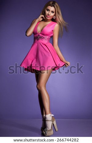 woman in pink dress on violet background