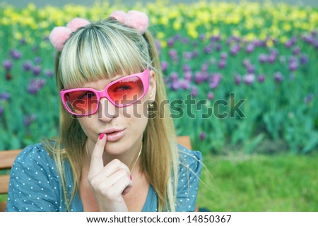 woman in pink glasses outdoor