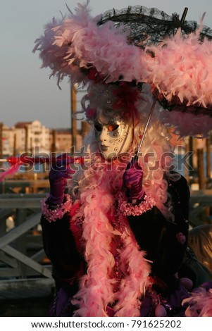 Woman In Pink Masquerade Dress And Mask At The Venice Carnival Italy