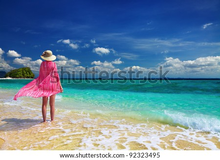 Woman in pink pareo and hat at the beach, Andaman Sea, Thailand - stock photo