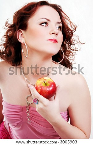 woman in pink with red apples on the white