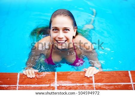 woman in pool - stock photo