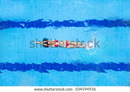 woman in pool - top view - stock photo