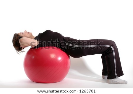 woman in position on fitness ball - stock photo
