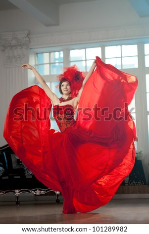 Woman in red at the luxurious interior - stock photo