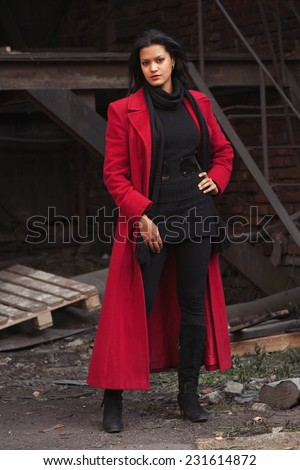 Woman in red coat - stock photo