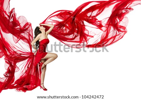 Woman in red dress flying on wind flow dancing over white background, Fashion Beauty Model, Posing with Red Cloth - stock photo