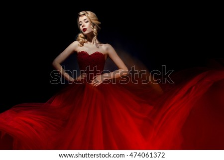Woman in red dress in dark background mixed light