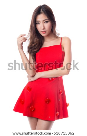 Woman in red dress isolated on white background