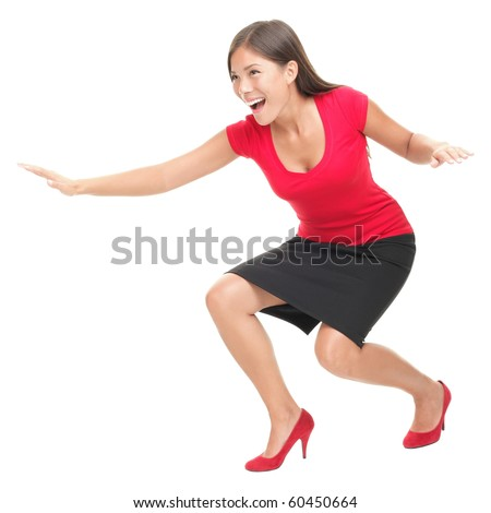 Woman in red having fun surfing / doing surf move. Casual funny young Asian / Caucasian businesswoman isolated on white background. - stock photo