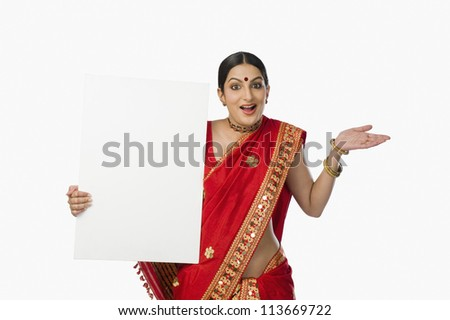 Woman in red mekhla holding a placard - stock photo