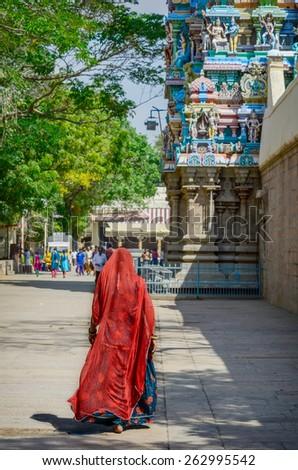 Woman in red sari at Meenakshi temple . India, Madurai, Tamil Nadu - stock photo