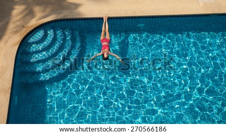 Woman In Red Swimming Suit Swimming and Relaxing In Big Blue 