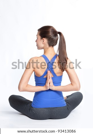 Woman in reverse prayer lotus pose