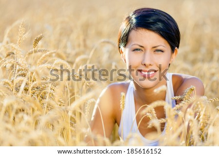 Woman in rye field. Concept of rural lifestyle - stock photo