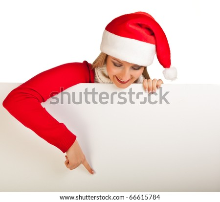 Woman in santa hat with christmas presents - stock photo
