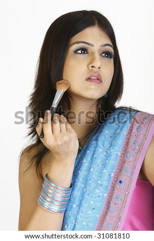 Woman in sari with a make-up brush