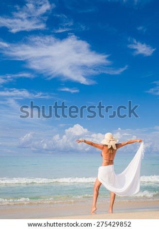 Woman in sarong on  the  beach  in Thailand - stock photo