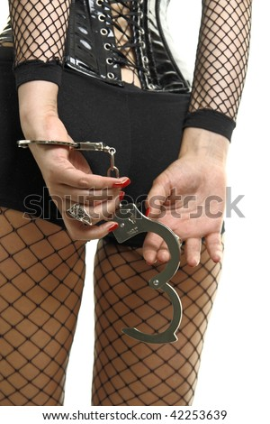 Woman in sexual black lingerie with handcuffs. Bondage concept. Studio shot. Isolated on white. - stock photo