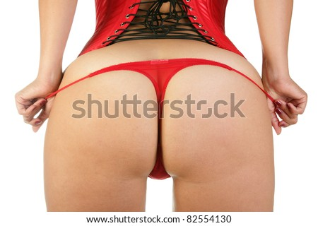 Woman in sexy red corset and red thongs - stock photo