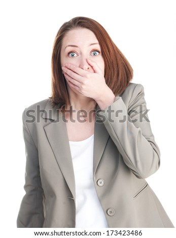 Woman in shock closing mouth with his hand isolated on white - stock photo
