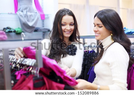 woman in shop look at clothes - stock photo