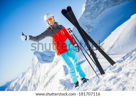 Woman in Ski resort smiling - stock photo
