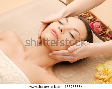 woman in spa salon lying on the massage desk - stock photo