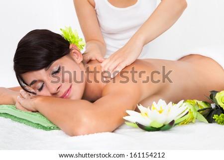 Woman In Spa Salon Lying On Towel - stock photo