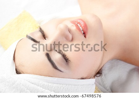 woman in spa with Towel on hair over white background - stock photo