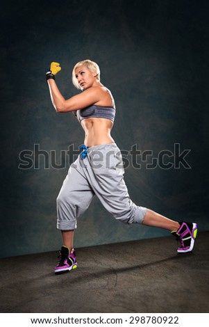 woman in sport dress at boxing exercise - stock photo
