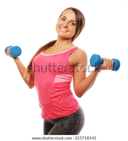 Woman in sport equipment practice with hand weights isolated on white - stock photo