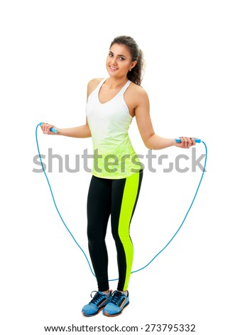 woman in sportswear holding a jumping-rope - stock photo