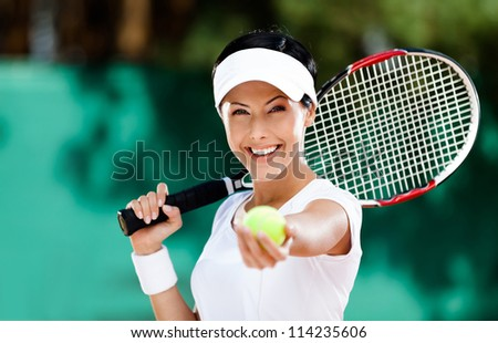 Woman in sportswear serves tennis ball. Tournament - stock photo