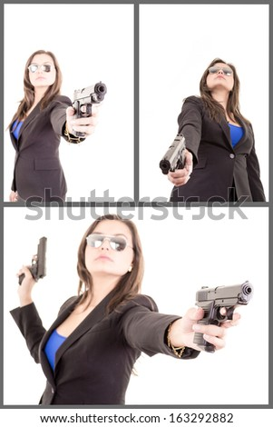 Woman in suit with handgun - stock photo