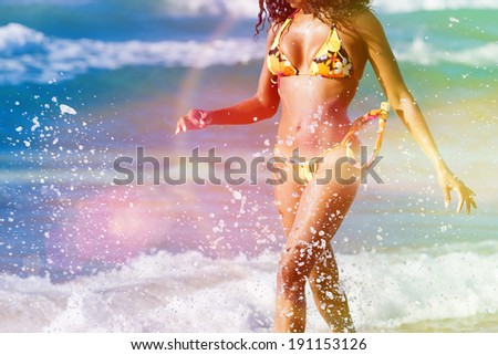 Woman in summer beach vacation walking in sun looking over the ocean - stock photo