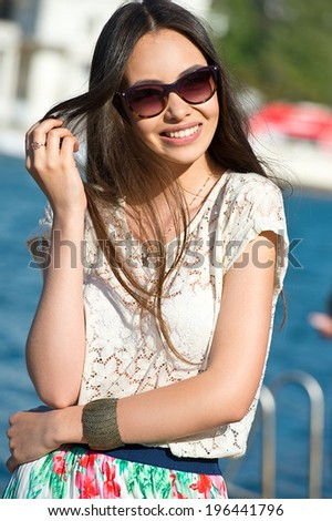 Woman in summer city on sunglasses