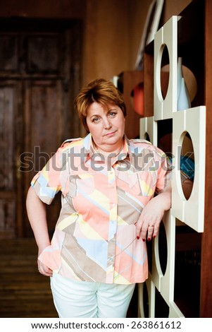 Woman in summer clothes standing near the closet at home - stock photo